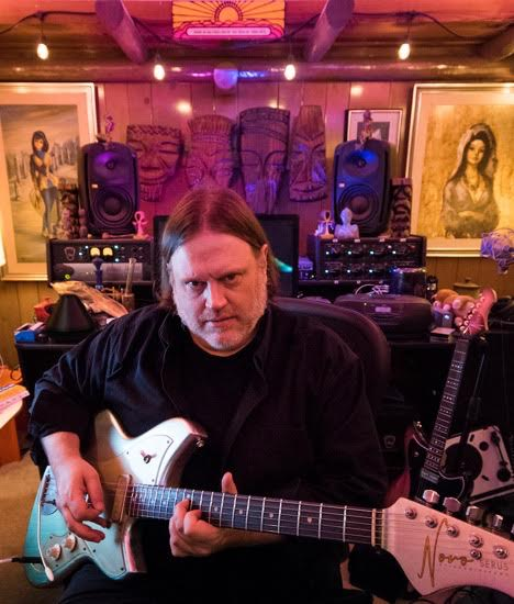 Matthew Sweet with guitar, seated